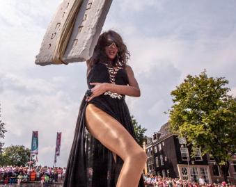 Dana Holds Up 10 Commandments At Pride
